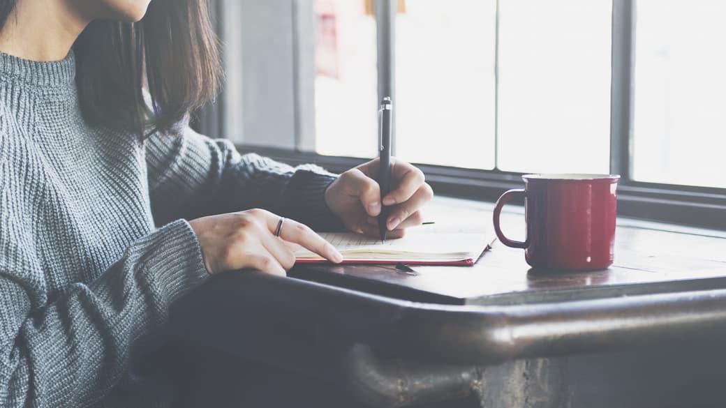 Woman-writing-on-notebook.jpg
