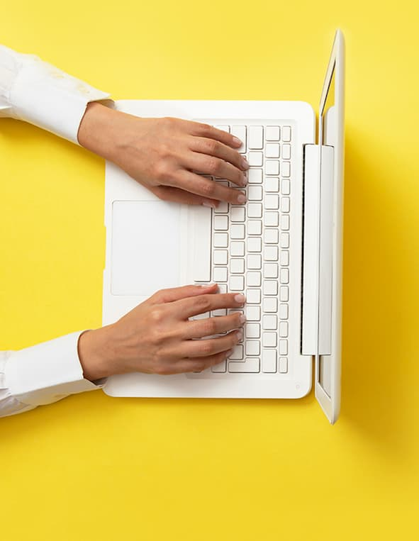 Laptop-in-yellow-background.jpg