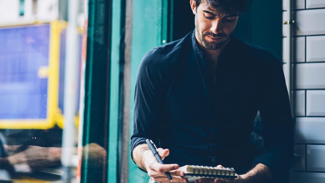 Man-writing-notebook.jpg